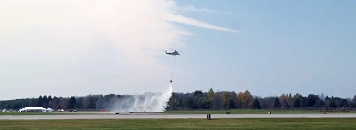 Kmax unmanned heavy lift helicopter water drop fire